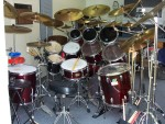 Eight Toms, D-W Double Bass Pedal, 18 Cymbals, Three Roto Toms, And Effects.
