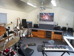 From The Back Of The Music Room, Amps, Custom Spreaker System By Terry Franker, 54 Inch Wide Screen, Even A Karaoke Machine.